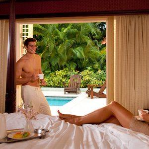 Couple On Bed Butler Village One Bedroom Poolside Villa Estate Suite Sandals Ocio Rios