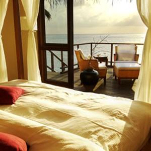 Kandolhu Island - water villa bedroom