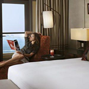 Luxury Dubai Holidays Amwaj Rotana Woman By Bed