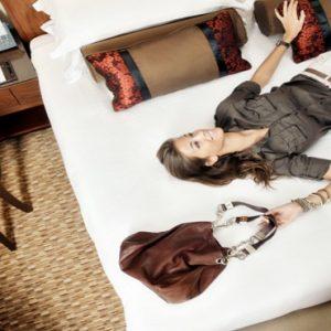 Luxury Dubai Holidays Amwaj Rotana Woman On Bed