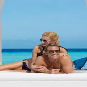 Luxury Mexico Holiday Packages Dreams Sands Cancun Resort And Spa Couple On Daybed