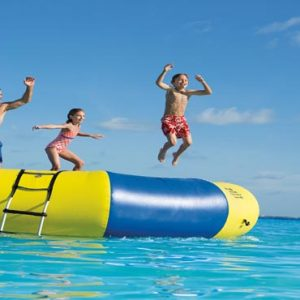 Luxury Mexico Holiday Packages Dreams Sands Cancun Resort And Spa Kids On Trampoline