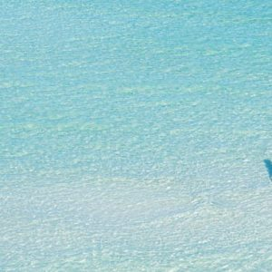 Luxury Mexico Holiday Packages Dreams Sands Cancun Resort And Spa Couple In Sea1