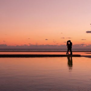 Luxury Mexico Holiday Packages Secrets Playa Mujeres Couple By Pool At Sunset