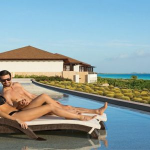 Luxury Mexico Holiday Packages Secrets Playa Mujeres Couple Infinity Pool1