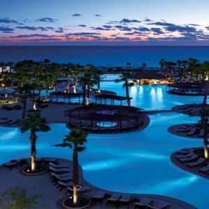 Luxury Mexico Holiday Packages Secrets Playa Mujeres Pool At Night