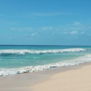 Luxury Mexico Holiday Packages Secrets The Vine Cancun Couple Walking On Beach