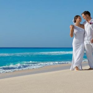 Luxury Mexico Holiday Packages Secrets The Vine Cancun Bride And Groom On Beach