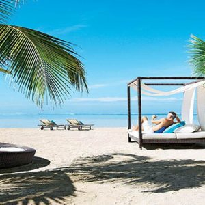 Mauritus holiday Packages Heritage Awali Golf & Spa Resort Relaxing On The Beach Cabana