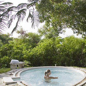 parrot cay by como - turqs and caicos lucury holidays - garden pool