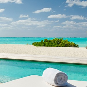 parrot cay by como - turqs and caicos lucury holidays - pool view of beach