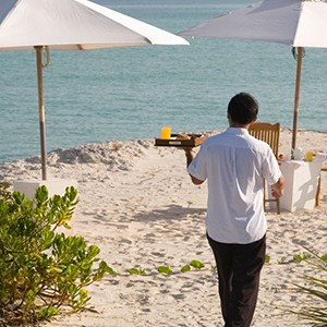 parrot cay by como - turqs and caicos lucury holidays - service on the beach