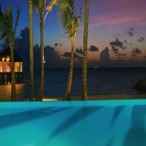 Ozen By Atmosphere At Maadhoo Island Luxury Maldives Honeymoon Packages Joie De Vivre Pool At Night