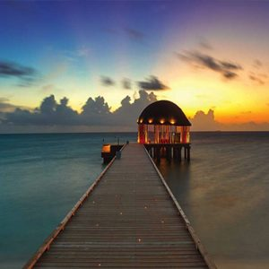 Ozen By Atmosphere At Maadhoo Island Luxury Maldives Honeymoon Packages Ozen Arrival Pavillion At Sunset