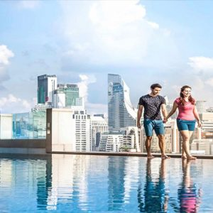 luxury Thailand holiday Packages Rembrandt Hotel Bangkok Couple Walking By Pool