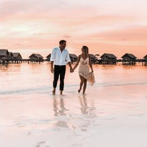 Luxury Maldives Holiday Packages Shangri La's Villingili Resort And Spa Couple On Beach At Sunset