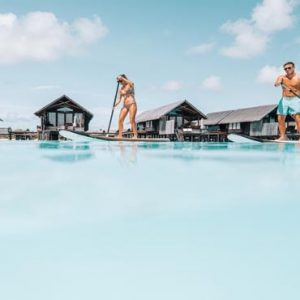 Luxury Maldives Holiday Packages Shangri La's Villingili Resort And Spa Standup Paddleboarding In The Lagoon