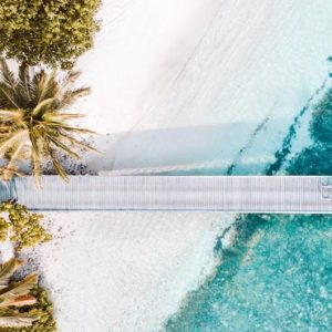Luxury Maldives Holiday Packages Shangri La's Villingili Resort And Spa Couple Cycling On Jetty Aerial View