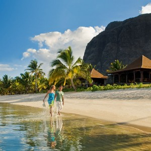 couple on the beach - lux le morne mauritius - luxury mauritius holiday packages