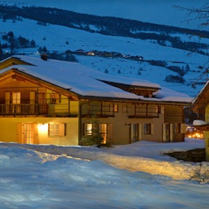 Pragelato Vialetta - Luxury Italy Holiday Packages - hotel at night in snow