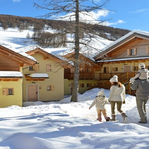 Pragelato Vialetta - Luxury Italy Holiday Packages - hotel exterior in the snow