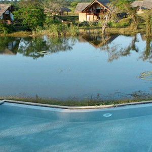 Jetwing Vil Uyana - Luxury Sri Lanka Holiday Packages - Pool and lake