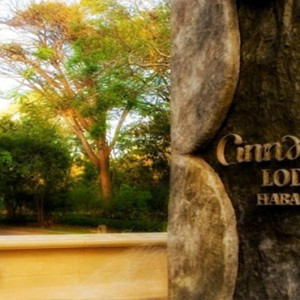 Cinnamon Lodge Habarana - Luxury Sri Lanka Holiday Package - Hotel logo on tree