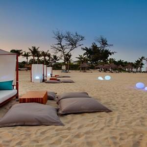 luxury vietnam holiday packages - pullman danang vietnam - azure beach lounge