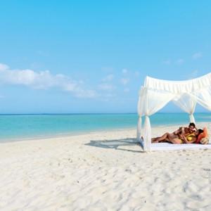Luxury Maldives holiday packages - Kanuhura Maldives - beach