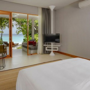Deluxe Beach Bungalow Dhigali Maldives Luxury Maldives Honeymoon Packages