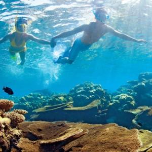 Luxury Maldives holiday packages - Kanuhura Maldives - snorkelling