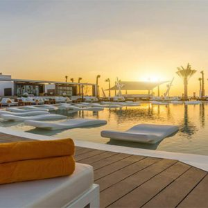 Nikki Beach Resort And Spa Luxury Dubai Honeymoon Packages Pool At Sunset