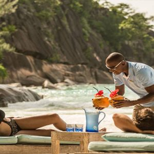 Four Seasons Resort Seychelles Luxury Seychelles holiday Packages Couple Relaxing On Beach