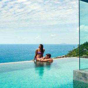 Four Seasons Resort Seychelles Luxury Seychelles holiday Packages Couple In Pool Ocean Gazing