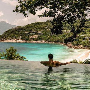 Four Seasons Resort Seychelles Luxury Seychelles holiday Packages Man In Pool