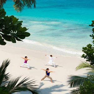Four Seasons Resort Seychelles Luxury Seychelles holiday Packages Yoga On Beach