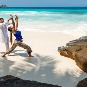 Four Seasons Resort Seychelles Luxury Seychelles holiday Packages Yoga On Beach1