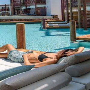 Luxury Greece Holiday Packages Stella Island Crete Women Relaxing By Swim Up Pool