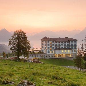 Luxury Switzerland Holiday Packages Hotel Villa Honegg Hotel Exterior At Sunset