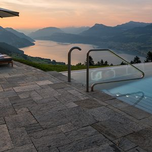 Luxury Switzerland Holiday Packages Hotel Villa Honegg Pool At Sunset