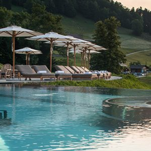 Luxury Switzerland Holiday Packages Hotel Villa Honegg Sun Loungers By The Pool