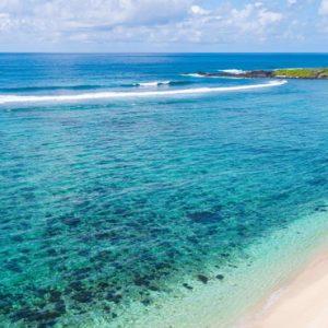 Luxury Mauritius Holiday Packages Anantara Iko Luxury Mauritius Resort & Villas Woman Strolling On Beach