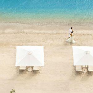 Couple Strolling On Beach Ikos Olivia Resort Greece Holidays